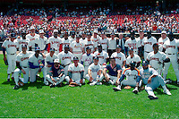 SAN FRANCISCO, CA - Old timers gather for a team picture on Old Timers Day at Candlestick Park in San Francisco, California in 1990. Among those in the picture include Joe Dimaggio, Willie Mays, Orlando Cepeda, Juan Marichal, Reggie Jackson, Billy Williams, Bill Rigney, Hank Sauer, Ron Cey and John Montefusco. Photo by Brad Mangin
