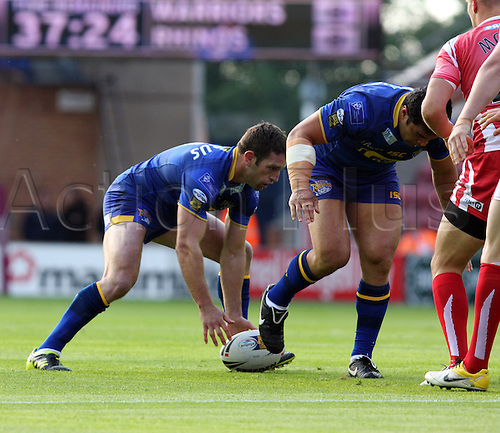 01.07.2011 Engage Super League Rugby from the DW Stadium. Wigan Warriors v Leeds Rhinos. Picture shows Danny Buderus about to pass the ball wide.