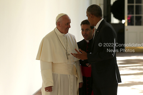 U.S. President Barack Obama (R) escorts Pope Francis (L) down the West Wing colonnade walk during the arrival ceremony at the White House on September 23, 2015 in Washington, DC. The Pope begins his first trip to the United States at the White House followed by a visit to St. Matthew's Cathedral, and will then hold a Mass on the grounds of the Basilica of the National Shrine of the Immaculate Conception. <br /> Credit: Alex Wong / Pool via CNP