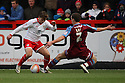 Luke Freeman of Stevenage (on loan from Arsenal) goes past Michael Kay of Tranmere. - Stevenage v Tranmere Rovers - npower League 1 - Lamex Stadium, Stevenage - 17th December 2011  .© Kevin Coleman 2011 ... ....  ...  . .