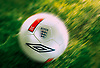Blurred Umbro England football on grass.