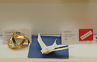 New York, NY, USA - June 23, 2012: The origami Model Menu along which are displayed the subjects of classes, including this complex swallow designed by Sipho Mabona. The OrigamiUSA 2012 Convention held at Fashion Institute of Technology, New York, attracts members from the USA with visitors from Asia, the Americas, and Europe. Attendees exhibit their work and take part in classes, and an exhibition of big folding.