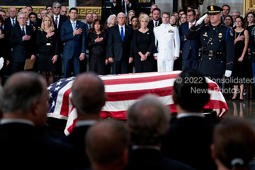 From left, Senate Majority Leader Mitch McConnell of Ky., Janna Ryan, House Speaker Paul Ryan of Wis., Karen Pence, Vice President Mike Pence, McCain's wife Cindy McCain, and McCain's sons Navy Lt. Jack McCain and Doug McCain watch as the casket of Sen. John McCain, R-Ariz., is laid in state in the Rotunda of the U.S. Capitol, Friday, Aug. 31, 2018, in Washington. (AP Photo/Andrew Harnik, Pool)