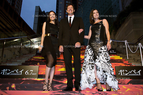"Tokyo, Japan - (L to R) The actress Meisa Kuroki, the Director Paul W. S. Anderson and Mila Jovovich appear at the Japan premier of ""Pompeii"" movie in Roppongi Hills on May 26, 2014. The Director Paul W. S. Anderson with his wife Mila Jovovich came to Japan to greet all the fans and promote the Movie. (Photo by Rodrigo Reyes Marin/AFLO)"