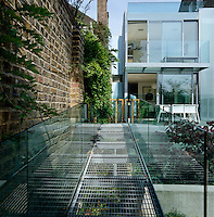 The modern extension to this Victorian property leads through massive sliding glass doors on to a garden designed by Jinny Blom