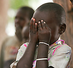 A girl in Rumbek, South Sudan plays peek-a-boo.