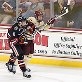 Adam Reid (NU - 8), Michael Matheson (BC - 5) - The Boston College Eagles defeated the visiting Northeastern University Huskies 3-0 after a banner-raising ceremony for BC's 2012 national championship on Saturday, October 20, 2012, at Kelley Rink in Conte Forum in Chestnut Hill, Massachusetts.