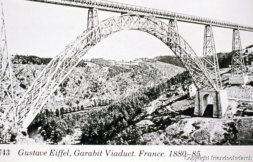 Garabit Viaduct is a railway arch bridge spanning the River Truyère in the mountainous Massif Central Region. Designed by Engineer Gustave Eiffel, 1880-85. Cantal, France. use of truss rather than solid beams.
