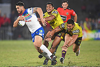 Shaun Johnson breaks the Broncos defence.<br />