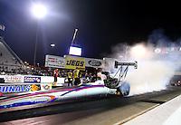 Sep 13, 2013; Charlotte, NC, USA; NHRA top fuel dragster driver Leah Pruett during qualifying for the Carolina Nationals at zMax Dragway. Mandatory Credit: Mark J. Rebilas-