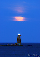 The moon rises above Whaleback Lighthouse from the Great Island Common in New Castle, New Hampshire