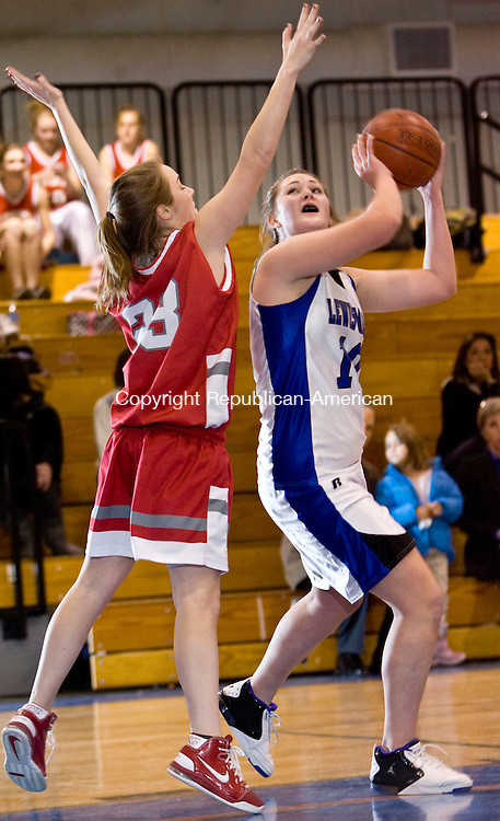 BURLINGTON, CT - 08 JANUARY 2009 -010909JT04-<br /> Northwestern's Sarah Raftery tries to block Lewis Mills's Amanda Adamski from making a shot during Friday's game at Lewis Mills. Northwestern won 43-40 in overtime.<br /> Josalee Thrift / Republican-American