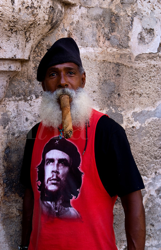 Old Havana Habana Cuba with man character with Che Tsirt and long huge cigar in costume and portrait