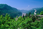 sculpture on hillsides above Yangtze River, blue sky day in Xiling Gorge, Three Gorges, China, Asia