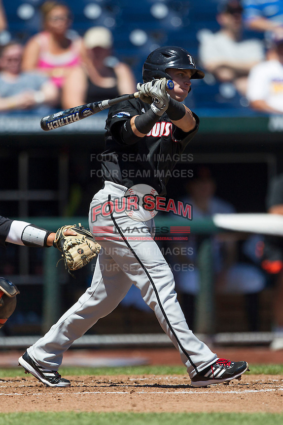 Louisville infielder Sutton Whiting (17) follows through on his swing against the Oregon State Beavers during Game 5 of the 2013 Men's College World Series on June 17, 2013 at TD Ameritrade Park in Omaha, Nebraska. The Beavers defeated Cardinals 11-4, eliminating Louisville from the tournament. (Andrew Woolley/Four Seam Images)