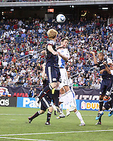 New England Revolution midfielder Pat Phelan (28) and San Jose Earthquakes defender Bobby Burling (2) leap for the ball off a corner kick at the Earthquakes' goal.  The New England Revolution and San Jose Earthquakes play to a scoreless draw at Gillette Stadium on May 15, 2010
