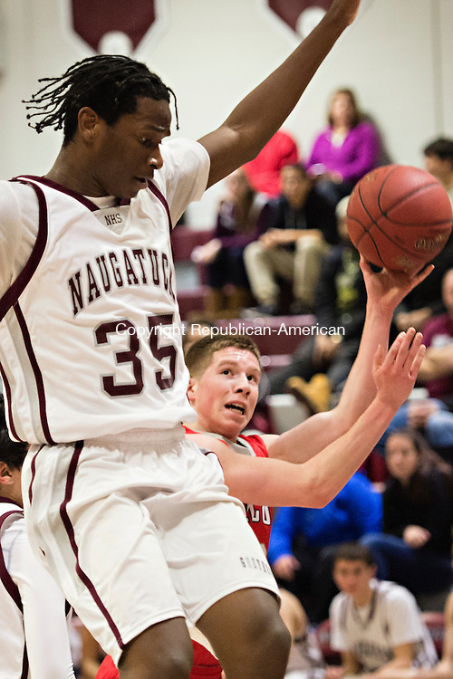 NAUGATUCK, CT - 29 December 2015-122915EC05--   Wolcott's Jack Rocco goes up to score next to Naugatuck defender Fejiro Onakpoma Tuesday night. Erin Covey Republican-American.