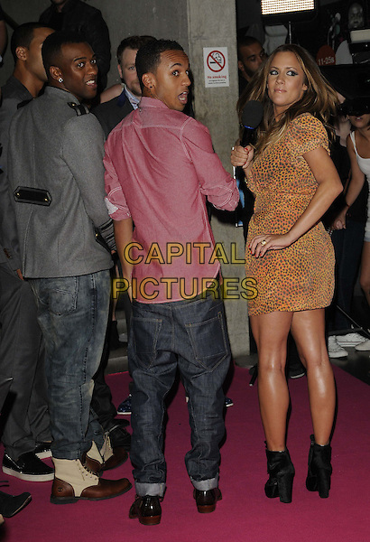 JB GILL, ASTON MERRYGOLD & CAROLINE FLACK.BT Digital Music Awards held at the Roundhouse, Chalk Farm, London, England..September 29th 2011.full length back behind rear looking over shoulder profile grey gray jacket red pink shirt orange yellow print dress mouth open funny jls.CAP/CAN.©Can Nguyen/Capital Pictures.
