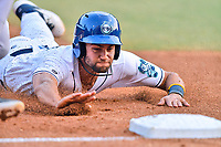 Asheville Tourists third baseman Johnny Cresto (17) slides into third base during a game against the Augusta GreenJackets  at McCormick Field on June 4, 2019 in Asheville, North Carolina. The GreenJackets defeated the Tourists 7-6. (Tony Farlow/Four Seam Images)