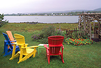 Annapolis Royal, NS, Nova Scotia, Canada - Colourful Wood Adirondack Chairs overlooking Annapolis River