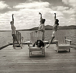 Ballet on the dock with dog. Moosehead Lake, ME. 1996. Three woman.