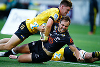 Jordie Barrett of the Hurricanes tackling Andre Esterhuizen of the Cell C Sharks during the Super Rugby match between the Hurricanes and the Cell C Sharks at Sky Stadium in Wellington, New Zealand on Saturday, 15 February 2020. Photo: Steve Haag / stevehaagsports.com