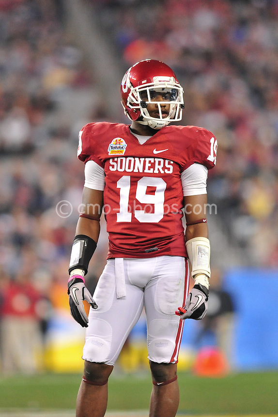 Jan 1, 2011; Glendale, AZ, USA; Oklahoma Sooners defensive back Demontre Hurst (19) looks to the sidelines during a stop in play in the 3rd quarter of the 2011 Fiesta Bowl against the Connecticut Huskies at University of Phoenix Stadium.  The Sooners won the game 48-20.