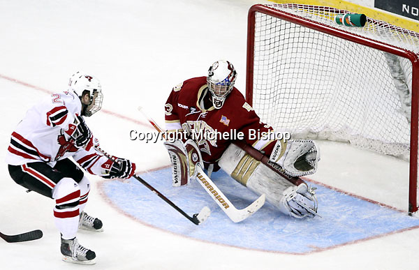 UNO's Matt White sets up to slide the puck under Denver goalie Adam Murray during the third period. White's short-handed goal put UNO up 4-2. Nebraska-Omaha beat Denver 5-2 Friday night at Qwest Center Omaha.  (Photo by Michelle Bishop)