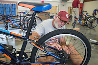 NWA Democrat-Gazette/ANTHONY REYES &bull; @NWATONYR<br /> Jack Holderby, with Monitor Elementary, assembles a 24-inch bike Wednesday, Aug. 12, 2015 at Sonora Elementary School in Springdale. The school purchased 32 bikes through a grant from the Walton Family Foundation for use in the school physical education department.