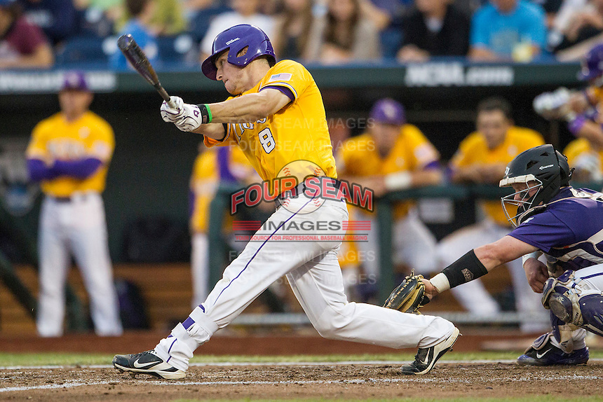 LSU Tigers shortstop Alex Bregman (8) swings the bat against the TCU Horned Frogs in Game 10 of the NCAA College World Series on June 18, 2015 at TD Ameritrade Park in Omaha, Nebraska. TCU defeated the Tigers 8-4, eliminating LSU from the tournament. (Andrew Woolley/Four Seam Images)
