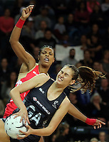 27.08.2016 Silver Ferns Ameliaranne Ekenasio and England's Stacey Francis in action during the Netball Quad Series match between teh Silver Ferns and England at Vector Arena in Auckland. Mandatory Photo Credit ©Michael Bradley.