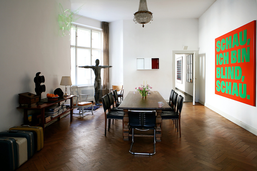 """contemporary wooden dining room...The 270 square feet house of Claus Nordechake and his family is located in Berlin, Germany and is decorated with many famous artworks mostly from his Gallery """"Nordechake""""."""