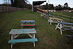 Picnic tables on the terracing at Lye Meadow before Alvechurch hosted Highgate United in a Midland Football League premier division match. Originally founded in 1929 and reformed in 1996 after going bust, the club has plans to move from their current historic ground to a new purpose-built stadium in time for the 2017-18 season. Alvechurch won this particular match by 3-0, watched by 178 spectators, taking them back to the top of the league.