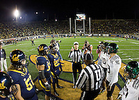California captains' Eric Stevens, Brian Schwenke, Aaron Tipoti, Josh Hill and Oregon captains watch referee Land Clark tosses the coin before the game against Oregon at Memorial Stadium in Berkeley, California on November 10th, 2012.   Oregon Ducks defeated California Bears, 59-17.