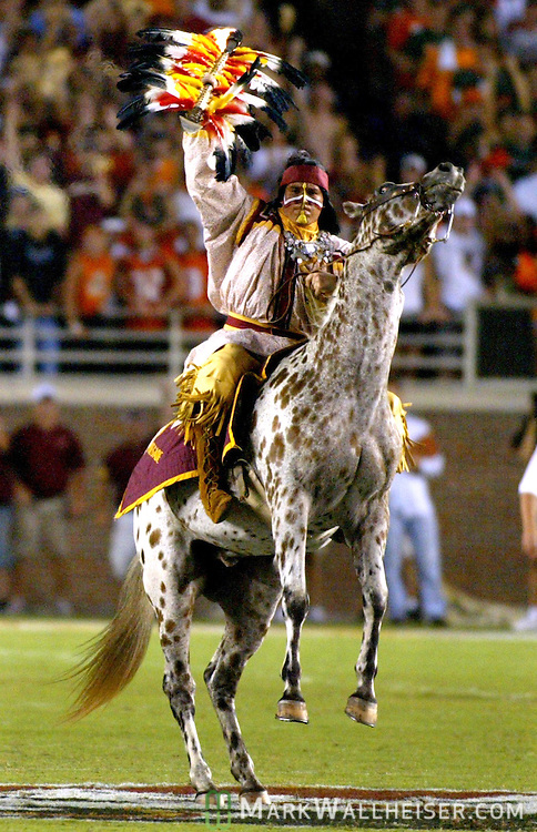 Florida State University mascot Chief Osceola rides his horse 'Renegade' in pre-game ceremonies before the Seminole's game with the University of Miami during their NCAA season opener in Tallahassee, Florida September 5, 2005. Recently, FSU's mascot was banned by the NCAA recently, for using American Indian mascots, nicknames and imagery in national championship events. After the school's protest, the NCAA took the school off of the banned list.
