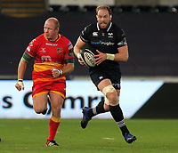 Alwyn Wyn Jones of the Ospreys (R) runs with the ball during the Guinness PRO14 match between Ospreys and Dragons at The Liberty Stadium, Swansea, Wales, UK. Friday 27 October 2017