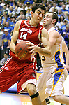 BROOKINGS, SD - JANUARY 12: Ricardo Andreotti #14 from the University of South Dakota tries to spin from the defense of Griffan Callahan #33 from South Dakota State in the first half Thursday night at Frost Arena in Brookings. (Photo by Dave Eggen/Inertia)