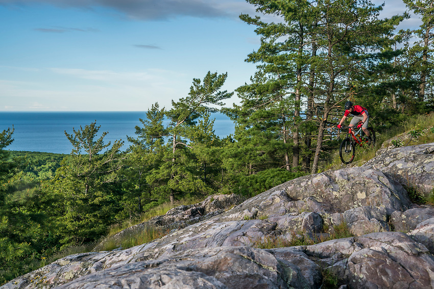 Mountain biking at Mount Marquette Overlook on the Noquemanon Trails Network South Trails in Marquette, Michigan.