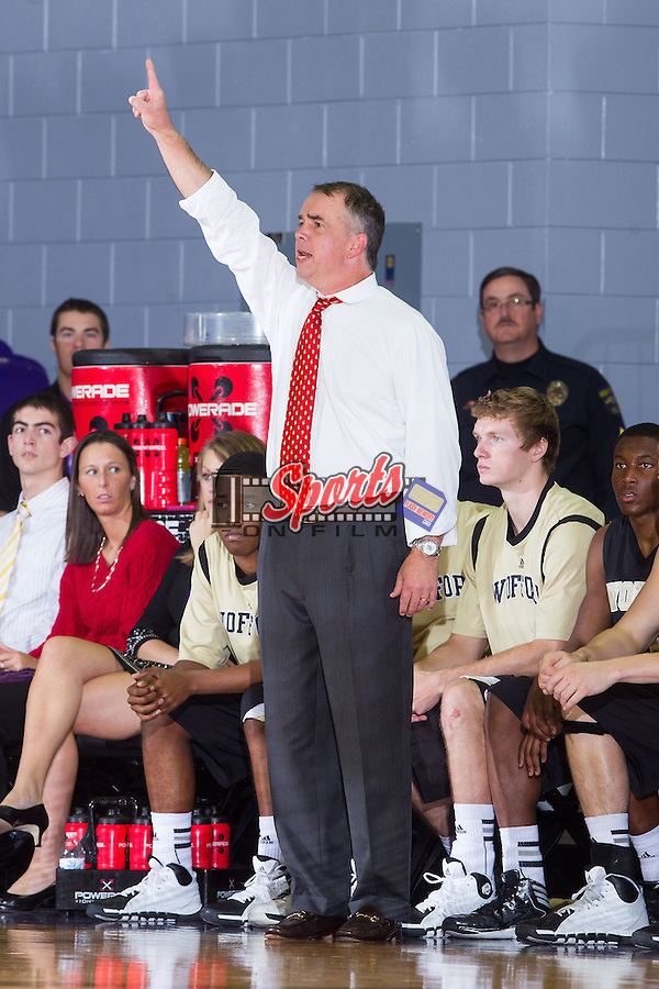 Wofford Terriers head coach Mike Young calls out a play during second half action against the High Point Panthers at Millis Athletic Center on November 24, 2013 in High Point, North Carolina.  The Panthers defeated the Terriers 66-56.   (Brian Westerholt/Sports On Film)