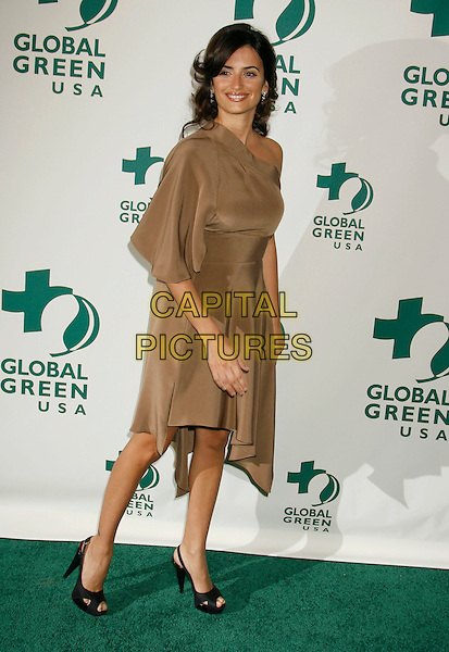 PENELOPE CRUZ.Global Green USA 3rd Annual Pre-Oscar Celebration to Benefit Global Warming held at Avalon, Hollywood, California, USA..February 21st, 2007.oscars full length brown beige satin one shoulder dress black peep toe peeptoe shoes platform.CAP/ADM/RE.©Russ Elliot/AdMedia/Capital Pictures