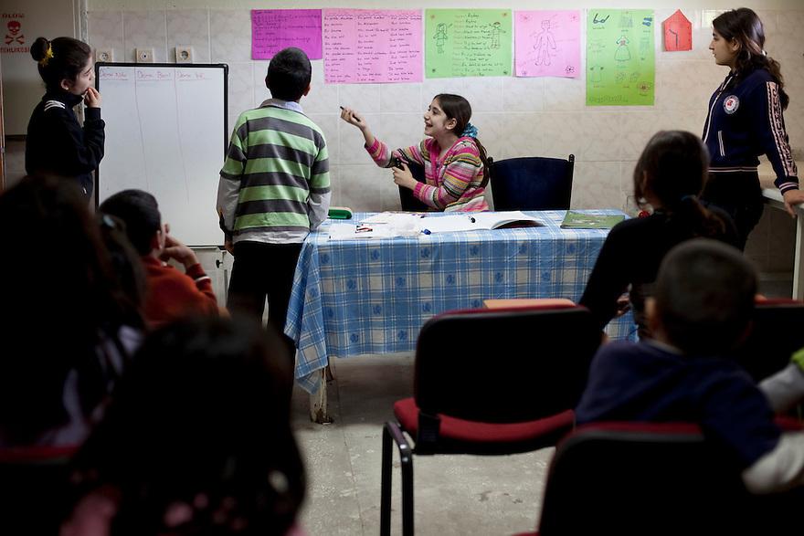 DIYARBAKIR, TURKEY-- May 14, 2011--Medya Ormek teaches Kurdish language classes on Saturday and Sunday mornings. Her students are neighborhood children, many of whom are Kurdish but never learned the language at home. PHOTO BY JODI HILTON
