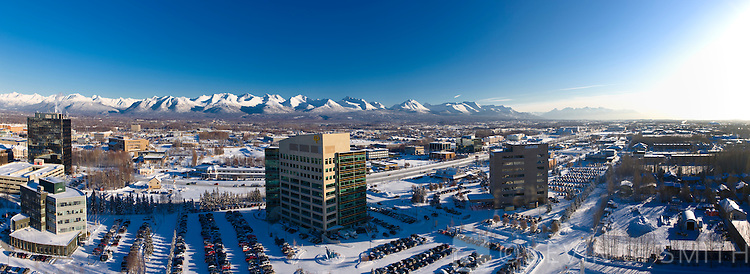 Arieal photo of Mid-Town Anchorage, Chugach Mountains in the background, winter, Southcentral Alaska, USA.
