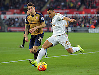 (L-R) Hector Bellerin of Arsenal closely marks Jefferson Montero of Swansea during the Barclays Premier League match between Swansea City and Arsenal at the Liberty Stadium, Swansea on October 31st 2015
