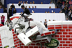 August 08, 2009: Jur Vrieling (NED) and his mount Pegasus crash through the wall. Land Rover International Puissance. Failte Ireland Horse Show. The RDS, Dublin, Ireland.