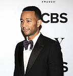 John Legend poses at the 71st Annual Tony Awards, in the press room at Radio City Music Hall on June 11, 2017 in New York City.