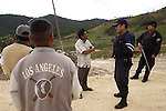 Timoteo Alejandro, center, appears in this photo file talking with state police in his village of Yosoyuxi, Oaxaca, November 18, 2005. Timoteo Alejandro was shot to death today May 20, 2010. Timoteo was one of the founders of the Autonomous municipality of San Juan Copala, town sieged by paramilitaries since last November who have assassinated almost twenty people.  Photo by Heriberto Rodriguez