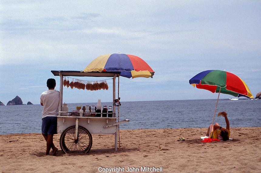 Tourist relaxing on the beach in Barra de Navidad, Mexico