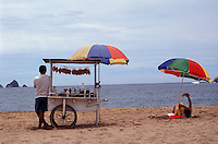 Tourist relaxing on the beach in Barra de Navidad, Mexico