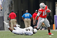 Ohio State Buckeyes quarterback J.T. Barrett (16) breaks a tackle from Navy Midshipmen cornerback Quincy Adams (5) as he runs the ball in the second quarter of the college football game between the Ohio State Buckeyes and the Navy Midshipmen at M&T Bank Stadium in Baltimore, Saturday afternoon, August 30, 2014. The Ohio State Buckeyes defeated the Navy Midshipmen 34 - 17. (The Columbus Dispatch / Eamon Queeney)