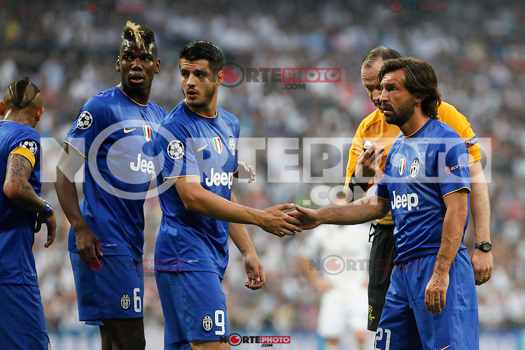 Juventus´s Pogba, Alvaro Morata and Andrea Pirlo during the Champions League semi final soccer match between Real Madrid and Juventus at Santiago Bernabeu stadium in Madrid, Spain. May 13, 2015. (ALTERPHOTOS/Victor Blanco) /NortePhoto.COM